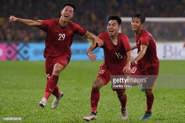 Pham Duc Huy#15 of Vietnam celebrates with his team-mates after scoring their 2nd goal during the AFF Suzuki Cup final first leg match between...