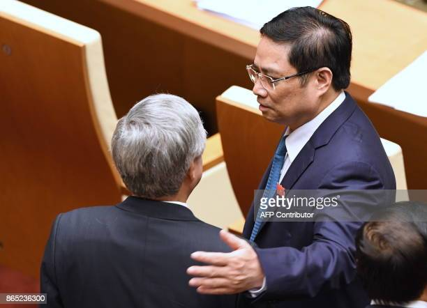 Pham Minh Chinh Politburo member and Head of the Central Organizing Committee of the Vietnam Communist Party chats with a deleguate prior to the...