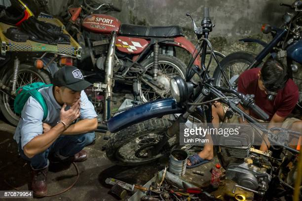 Pham Ngoc Thach 27 a Minsk motorcycle enthusiast turned into professional engineer finetunes his own Minsk motorcycle in preparation for an offroad...