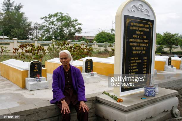 Pham Thi Thuan a survivor of the My Lai massacre visits the mass grave in Son My village in Quang Ngai province on March 15 2018 The massacre which...