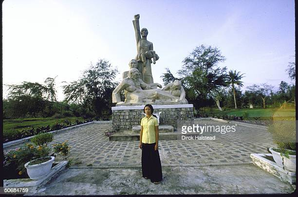 Pham Thi Trinh one of the few survivors of My Lai Massacre standing in front of monument honoring victims