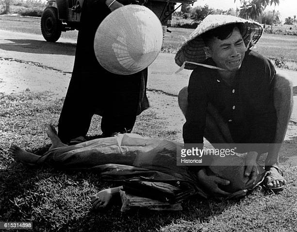 Pham Tong mourns the death of his eightyear old daughter Pham Thi Hai who was killed by the Vietcong in Binh Dinh Province Central Vietnam Sept 1964