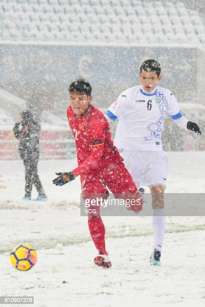 Pham Xuan Manh of Vietnam and Azizjon Ganiev of Uzbekistan compete for the ball during the AFC U23 Championship China 2018 final match between...