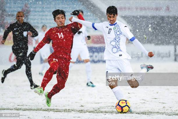 Phan Van Duc of Vietnam and Dostonbek Khamdamov of Uzbekistan compete for the ball during the AFC U23 Championship China 2018 final match between...
