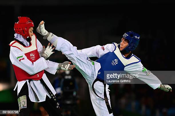 Phannapa Harnsujin of Thailand competes against Kimia Alizadeh Zenoorin of the Islamic Republic of Iran during the Women's 57kg Repechage Taekwondo...