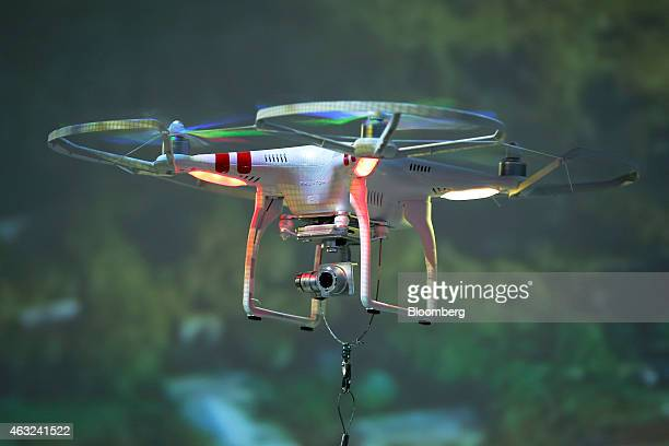 Phantom 2 Vision drone manufactured by SZ DJI Technology Co flies during the CP Camera and Photo Imaging Show in Yokohama Kanagawa Prefecture Japan...