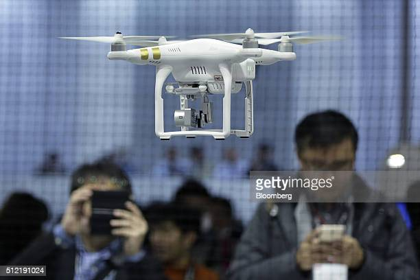 DJI Phantom 3 Professional a drone manufactured by SZ DJI Technology Co flies during a demonstration at the CP Camera and Photo Imaging Show in...