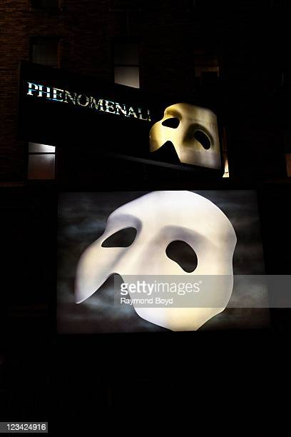 Phantom Of The Opera mask billboard in the Theatre District of Times Square at night in New York New York on AUG 03 2011