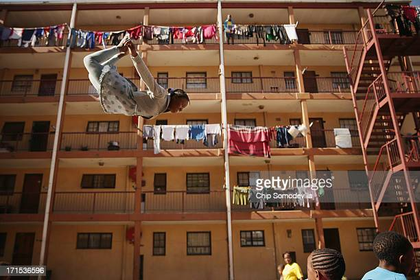 Phaphama Nxumalo a member of the Alexandra Trampoline Club practices in an alleyway between apartment blocks June 26 2013 in Johannesburg South...