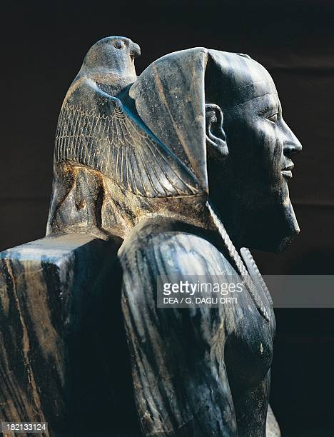 Pharaoh Khafre on the throne with the wings of the falcon god Horus wrapped around his head diorite statue 168cm x 57cm from Giza Detail Egyptian...