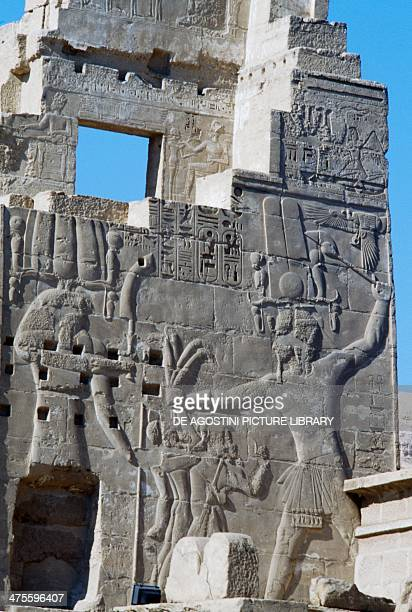 Pharaoh sacrificing the seven leaders of the conquered peoples to the God Harmakhis relief from the left wall of the fortified gate of the Temple of...