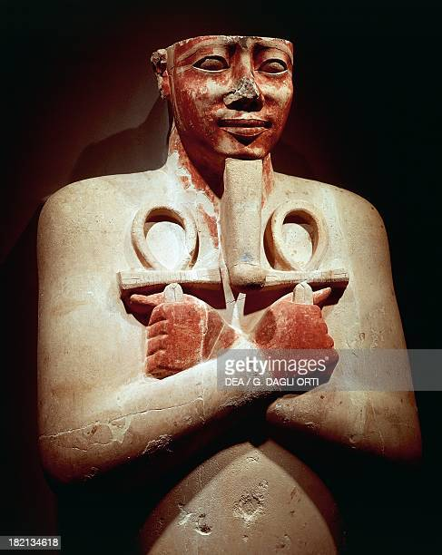 Pharaoh Sesostris I with two ankh crosses tight across his chest stone statue from the Temple of AmunRa at Karnak Egyptian Civilisation New Kingdom...