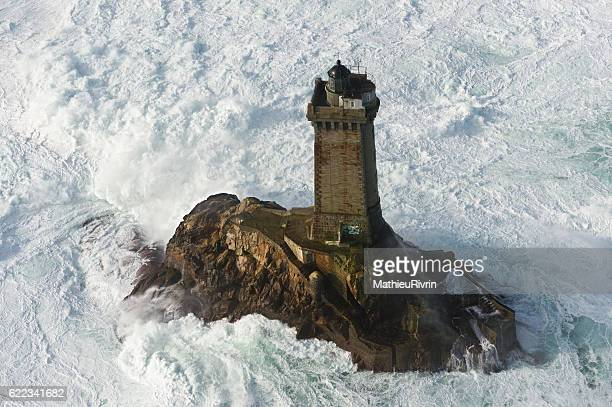 phare de la vieille in the storm - finistere stock photos and pictures