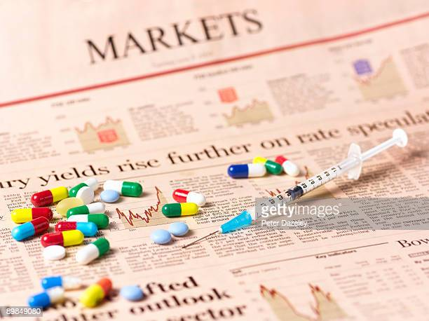 Pharmaceutical products against financial papers.