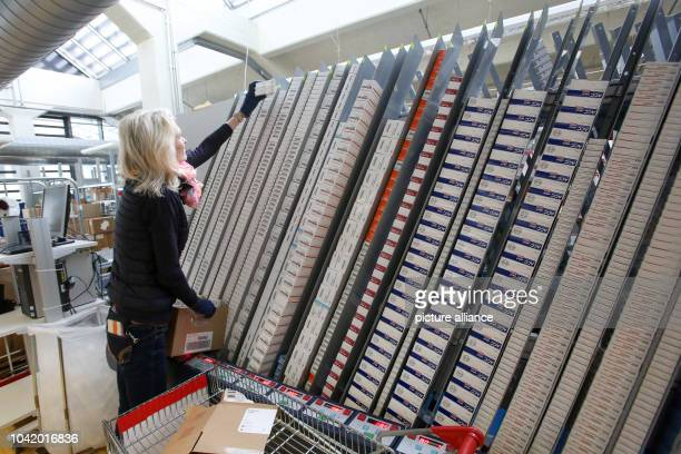 Pharmaceutical products are stored in a pharmacy automation system in the logistics centre of the mailorder pharmarcy aporot in Hamburg Germany 21...