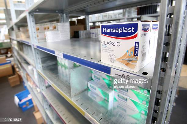 Pharmaceutical products including Hansaplast plasters seen on shelves in the logistics centre of the mailorder pharmarcy aporot in Hamburg Germany 21...