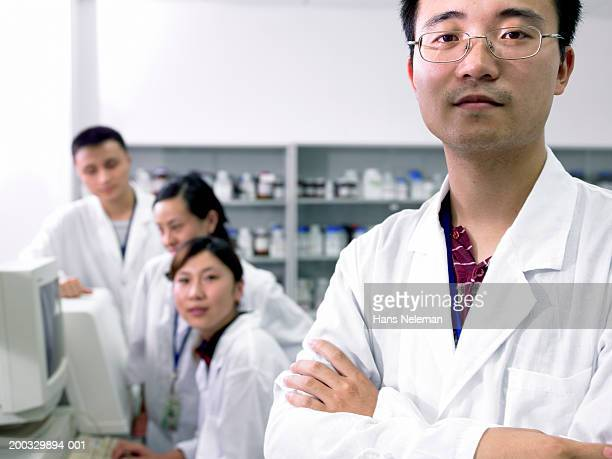 Pharmaceutical researchers in lab (focus on man in foreground)