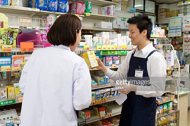 Pharmacist and Clerk of Drugstore Talking
