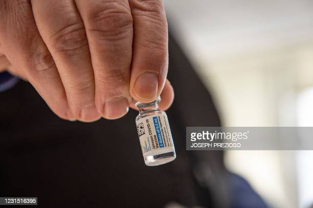 Pharmacist Antoun Houranieh holds a vial of the Johnson & Johnson Covid-19 Janssen Vaccine at the US Department of Veterans Affairs' VA Boston...