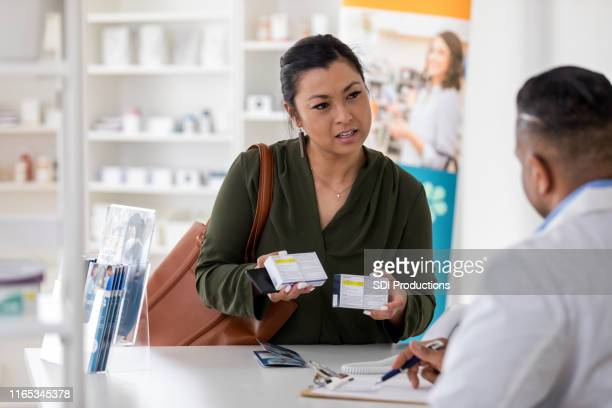pharmacist asks pharmacist question about medication - generic drug stock pictures, royalty-free photos & images