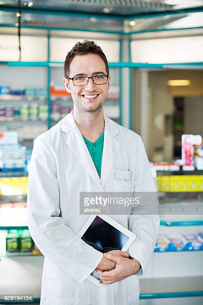 Pharmacist at drugstore with digital tablet