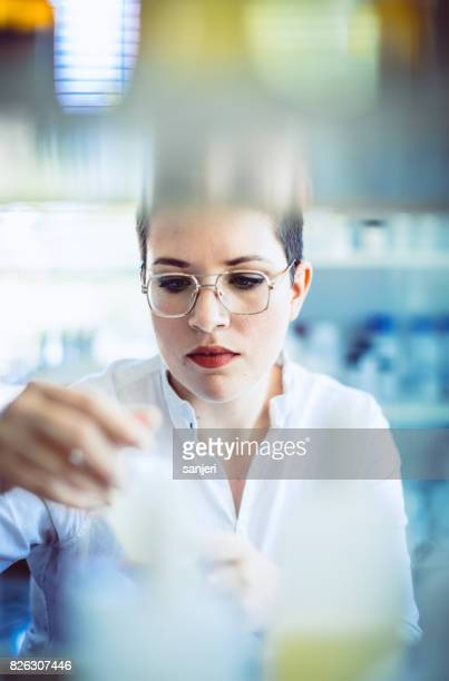 Pharmacist Checking Inventory