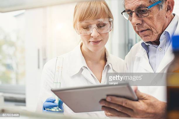 Pharmacist Discussing and Using Digital Tablet