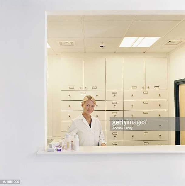 Pharmacist Dispensing Drugs in a Hospital