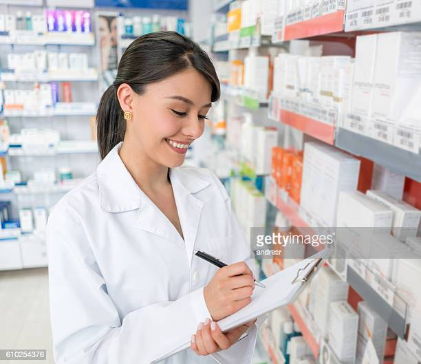 Pharmacist doing the inventory at a drugstore