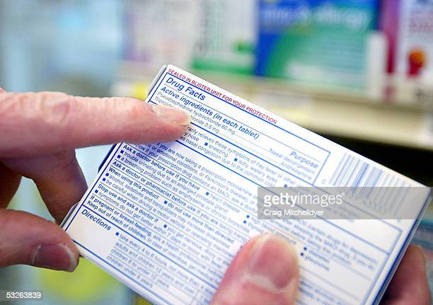 Pharmacist Ed Cole points out the active ingredient of over-the-counter cold medicine at Hi-School Pharmacy store on July 20, 2005 in Milwaukie,...