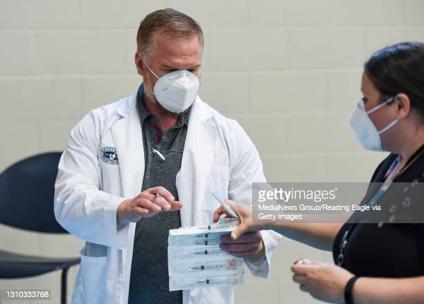 Pharmacist Eric Esterbrook. At the Olivet Boys and Girls Club Pendora site in Reading, Pennsylvania where the club was running a COVID-19 vaccine...