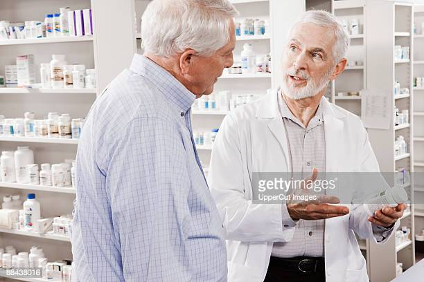 Pharmacist explaining medication to customer