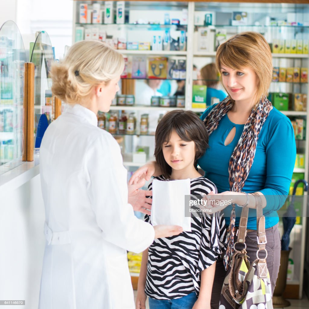 ed4495502d1 Pharmacist Giving Medication To A Mother And Daughter Stock Photo ...