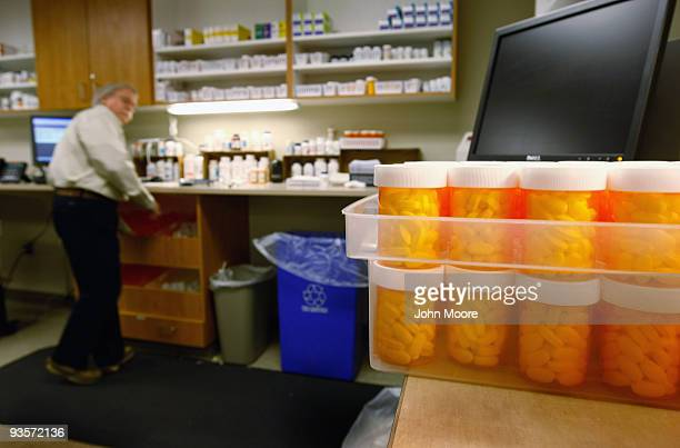 Pharmacist Hank Wedemeyer fills prescriptions as generic diabetes medicine awaits distribution at a community health center for lowincome patients on...