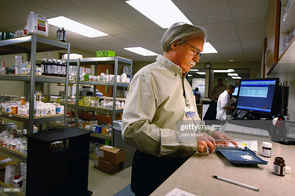 Pharmacist Hank Wedemeyer fills prescriptions at a community health center for low-income patients on December 1, 2009 in Aurora, Colorado. The Metro Community Provider Network (MCPN), which has 11 health centers in the Denver area, has seen a 138 percent increase in patients during the last year of recession. Community health centers such as MCPN could play a major role nationally if health care reform is passed, with increased subsidies from the federal government as well as millions of newly-insured low-income citizens seeking care.
