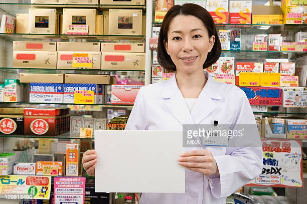 Pharmacist Holding a Board