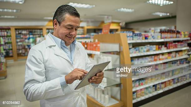 Pharmacist holding a digital tablet