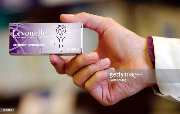 A pharmacist holds a pack of Levonelle March 23 2002 at a drugstore in London Levonelle is the UK brand name for Levonorgestrel more commonly known...