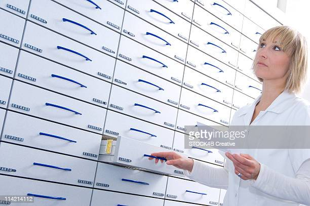 Pharmacist in front of a cabinet
