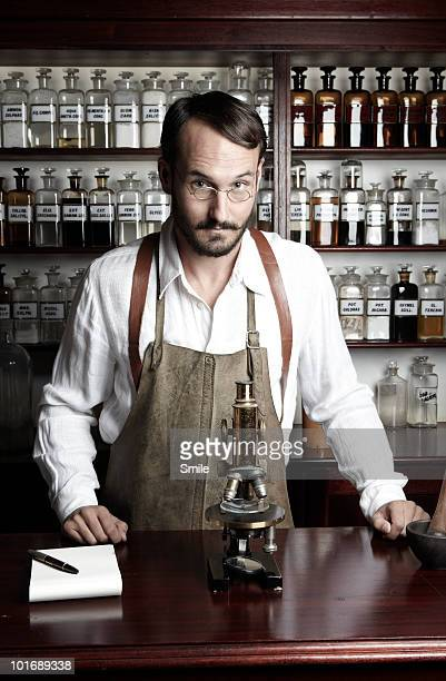 Pharmacist in front of medicine bottles