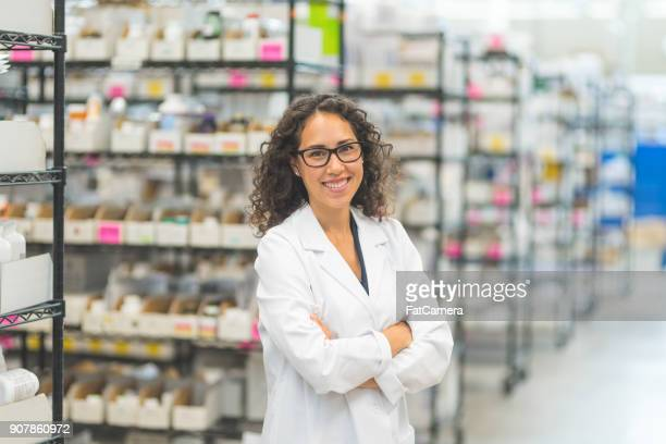 pharmacist in stockroom - pharmacist stock pictures, royalty-free photos & images