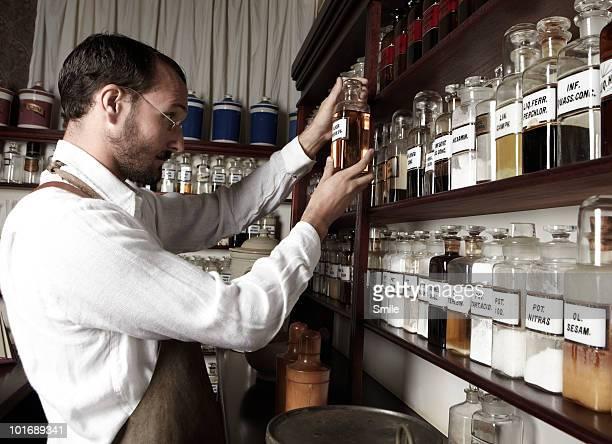 Pharmacist inspecting a bottle's label