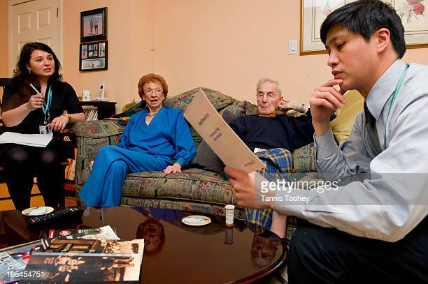 Pharmacist Norman Umali right reviews the latest prescriptions for Corry Alfred who has dementia and was discharged from Toronto General after a...