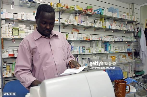 Pharmacist over looking patients looks over patients prescription