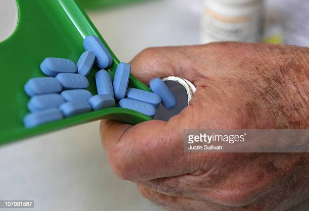 A pharmacist pours Truvada pills back into the bottle at Jack's Pharmacy on November 23 2010 in San Anselmo California A study published by the New...