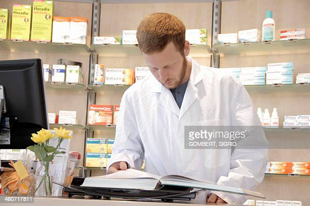 pharmacist reading - sigrid gombert stock pictures, royalty-free photos & images
