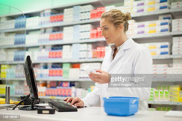 pharmacist researching medication - pharmacist stock pictures, royalty-free photos & images