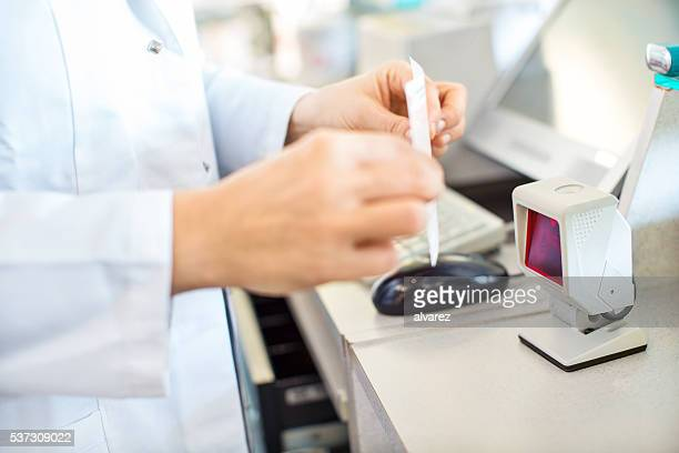 Pharmacist searching prescription medication in the database