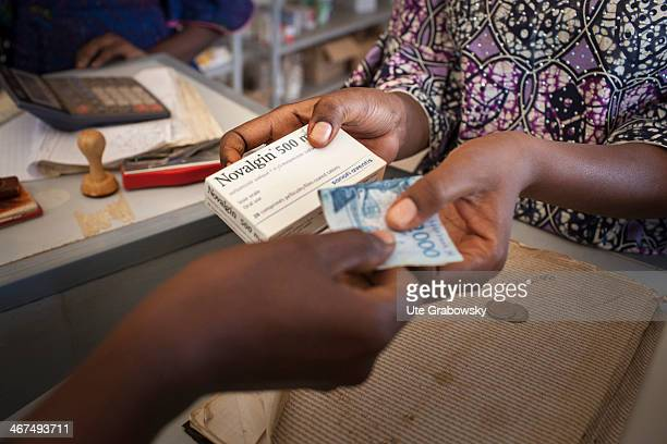 Pharmacist selling Novalgin to a customer in a Nigerian pharmacy on December 10 in Niamey Niger Novalgin is a analgesic pain reliever and a...