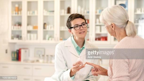 Pharmacist Talking to Senior Woman